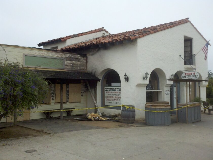 Two buildings in Old Town San Diego were damaged in a fire early Saturday morning, including a historic building home to Toby's Candle & Soap Shop, officials said.