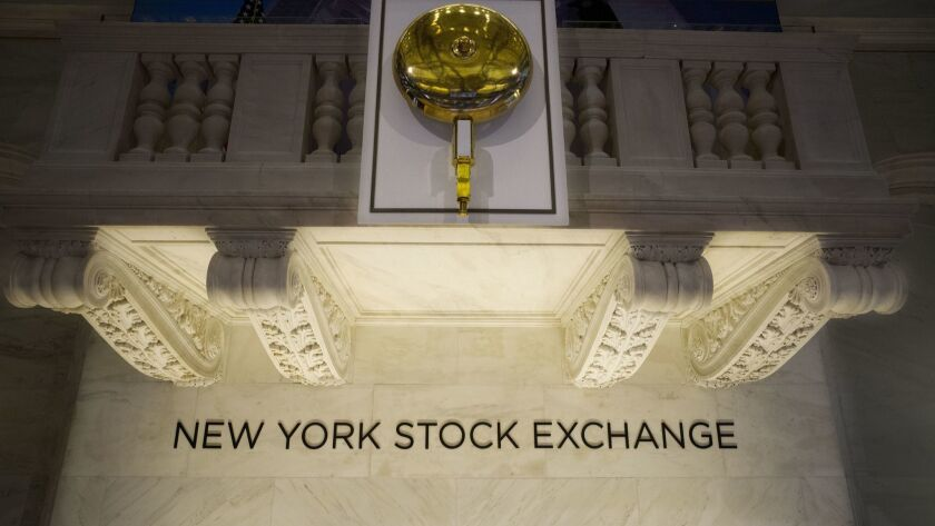 FILE- In this May 10, 2018, file photo, the opening bell hangs above the trading floor at the New Yo
