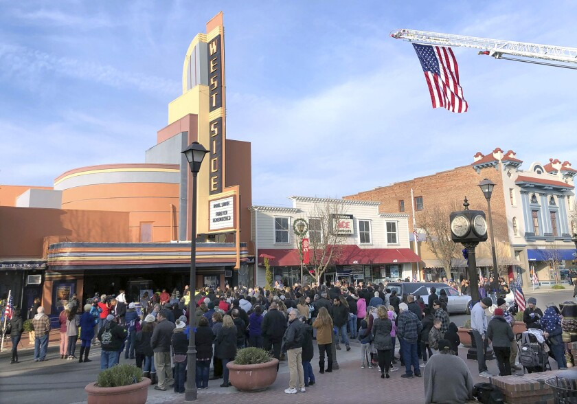 People gather outside the West Side Theatre into the Westside Theatre for the public viewing of Newm
