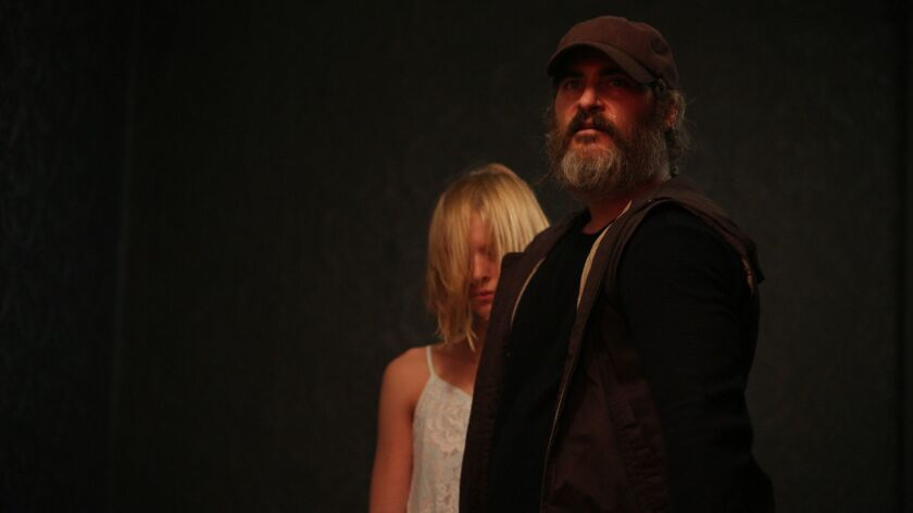 "Joaquin Phoenix as Joe and Ekaterina Samsonov as Nina in ""You Were Never Really Here."" Credit: Amazo"