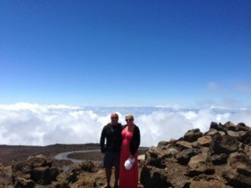 The Ranglases at the top of Haleakala Volcano in Hawaii, part of the trip they won.