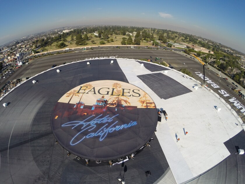 The roof of the revitalized Forum in Inglewood being outfitted with a 407-foot in diameter replica of the Eagles' 'Hotel California' vinyl LP in conjunction with the Eagles reopening the arena with six concerts in January.