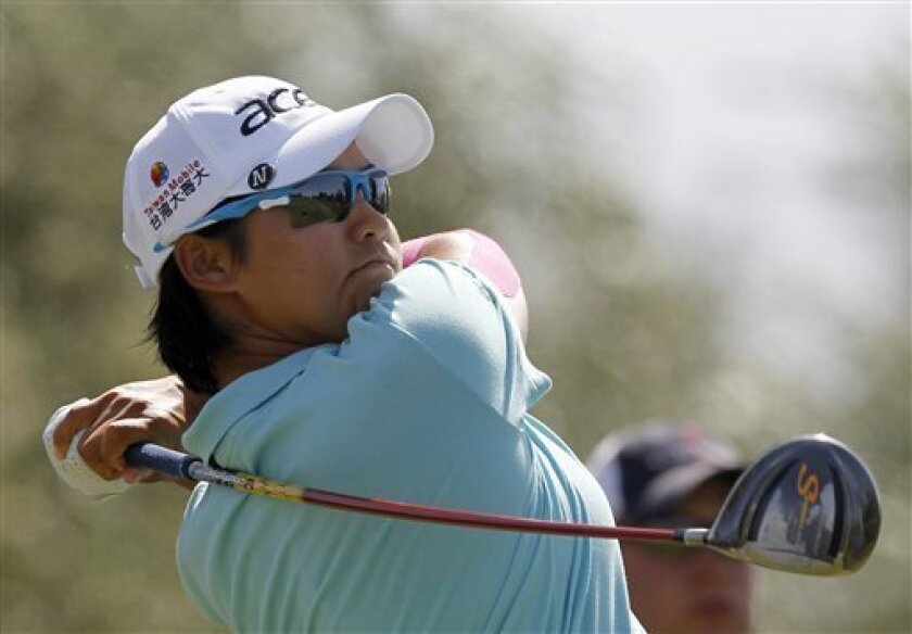 Yani Tseng, of Taiwan, watches her tee shot on the seventh hole during the third round of the LPGA Kraft Nabisco Championship golf tournament in Rancho Mirage, Calif., Saturday, March 31, 2012. (AP Photo/Chris Carlson)