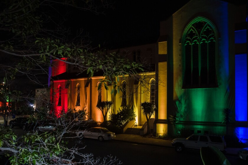 St Paul's Episcopal Cathedral lit in rainbow colors to honor the LGBTQ community.