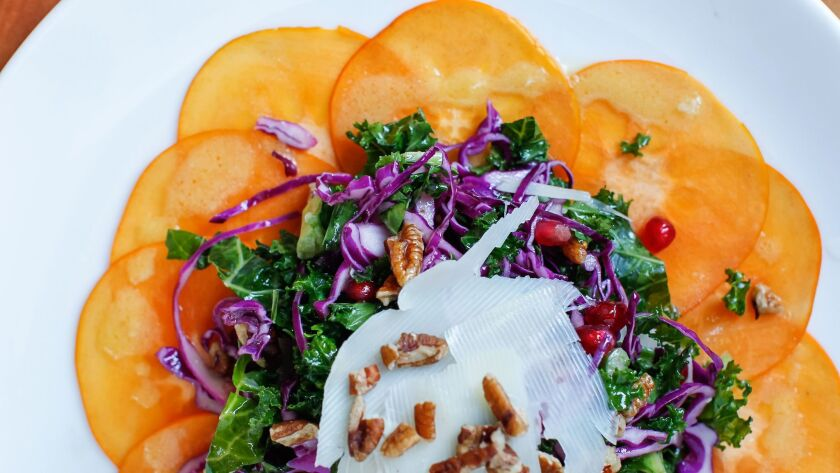 This seasonal Persimmon Salad is on chef Tim Kolanko's Thanksgiving menu.