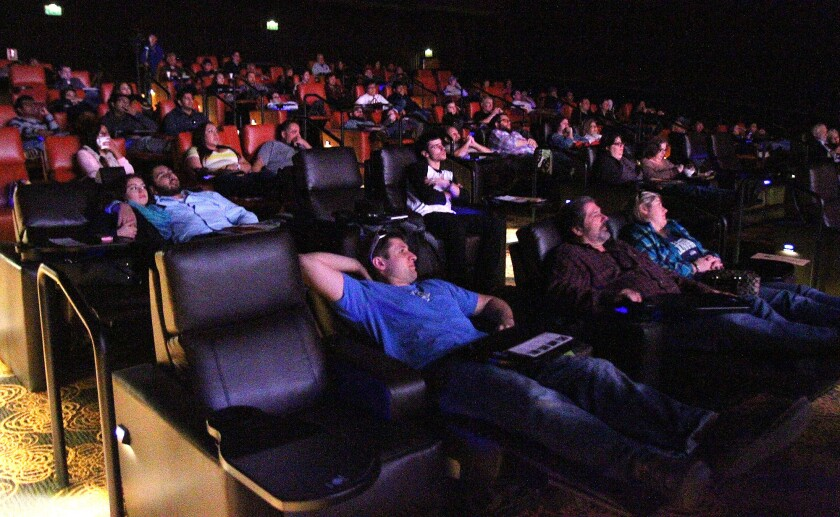 Theater-goers await a screening at the Five Star Cinema in downtown Glendale that shuttered nearly three years ago. A new theater dining chain, Studio Movie Grill, is moving into the space and is expected to open this fall.