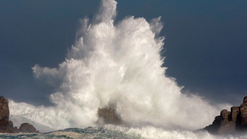 Large waves break off the shoreline Wednesday, Nov. 9, 2016, in Pacific Grove, Calif. A weather fron