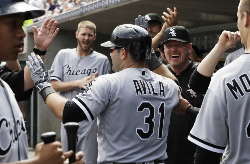 Chicago White Sox's Alex Avila is greeted in the dugout after a solo home run during the fourth inning of a baseball game against the Detroit Tigers, Wednesday, Aug. 31, 2016, in Detroit. (AP Photo/Carlos Osorio)