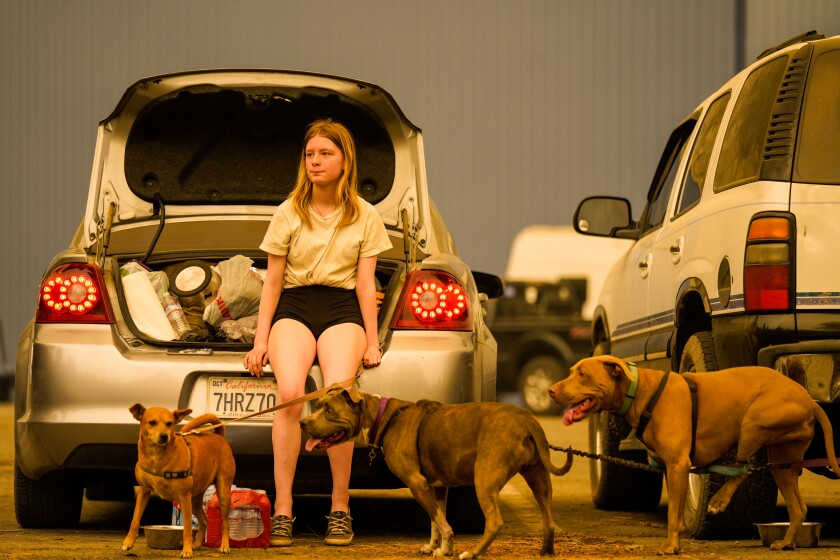 Kelsey Mueller, 16, waits with her family to be evacuated from the Creek fire at the Shaver Lake Marina in Fresno County.