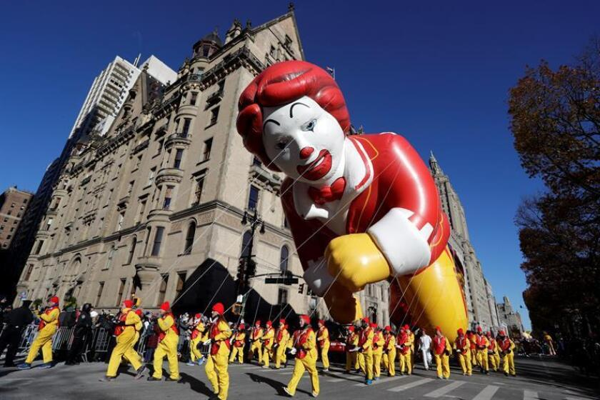 The Ronald McDonald balloon floats down Central Park West during the 92nd-annual Macy's Thanksgiving Day Parade in New York, New York, USA, on Nov. 22, 2018. The annual parade, which began in 1924, features giant character balloons floating above the streets of Manhattan. EPA-EFE/JASON SZENES