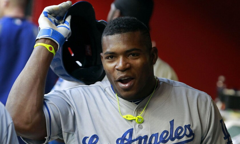 Dodgers right fielder Yasiel Puig celebrates after scoring on a home run by Adrian Gonzalez during the third inning of the team's win over the Arizona Diamondbacks on Saturday.