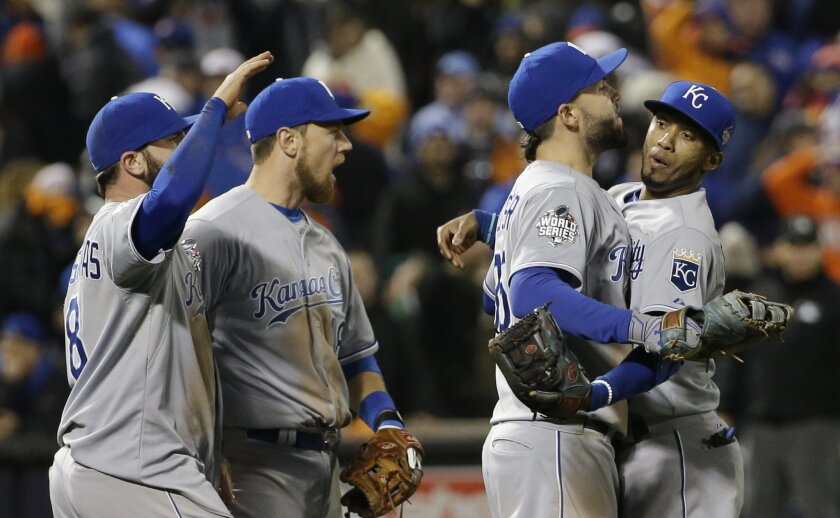Kansas City Royals' Alcides Escobar, Eric Hosmer, Mike Moustakas and Ben Zobrist celebrate after Game 4 of the Major League Baseball World Series against the New York Mets Saturday, Oct. 31, 2015, in New York. The Royals won 5-3 to take a 3-1 lead in the series. (AP Photo/David J. Phillip)