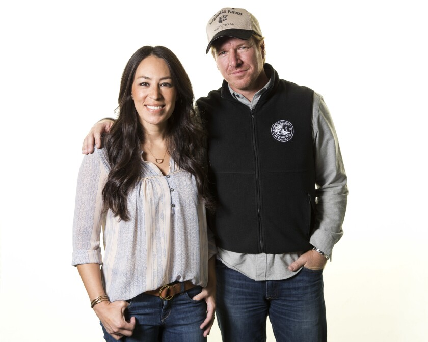 """FILE - In this March 29, 2016, file photo, Joanna Gaines, left, and Chip Gaines pose for a portrait in New York to promote their home improvement show, """"Fixer Upper,"""" on HGTV. The """"Fixer Upper"""" series, which ran for five seasons before airing its final episode in April 2018, is coming back and will air exclusively on Magnolia Network when it launches in 2021. (Photo by Brian Ach/Invision/AP, File)"""