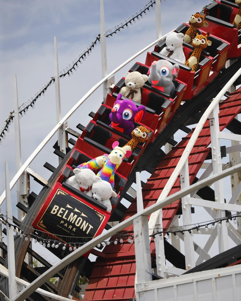 Stuffed animals ride the Giant Dipper roller coaster at Belmont Park in Mission Beach on June 1, 2020. The park has been running the coaster to keep it from tightening up during the recent closures.