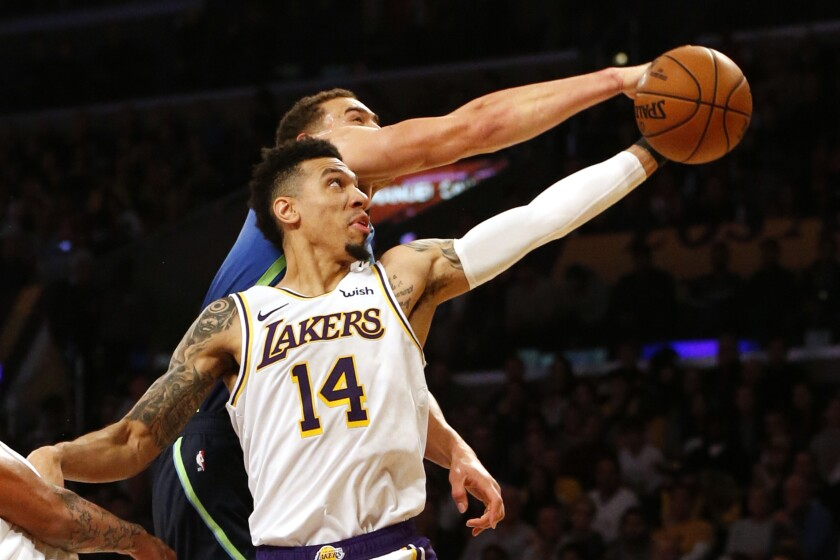 Lakers guard Danny Green tries to pull down a rebound against Mavericks forward Dwight Powell during a game on Dec. 1, 2019.