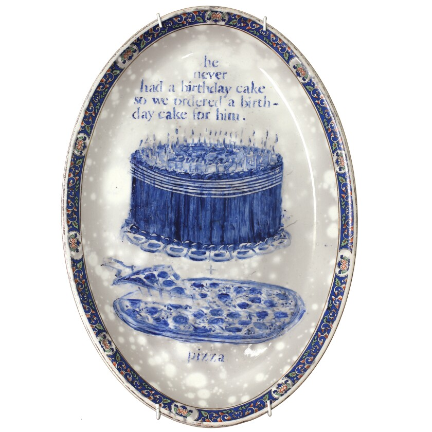 """""""Indiana 05 May 2007. Pizza and birthday cake shared with 15 family and friends,"""" by Julie Green, 2007, part of """"The Last Supper"""" series on view at the American Museum of Ceramic Art. The platter is 7 inches by 12 inches."""