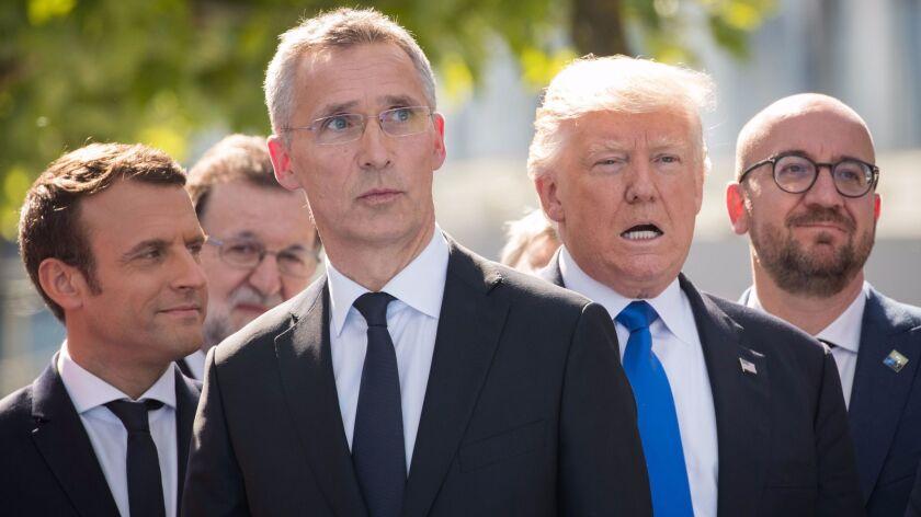 (L-R) French President Emmanuel Macron, NATO Secretary General Jens Stoltenberg, US President Donald