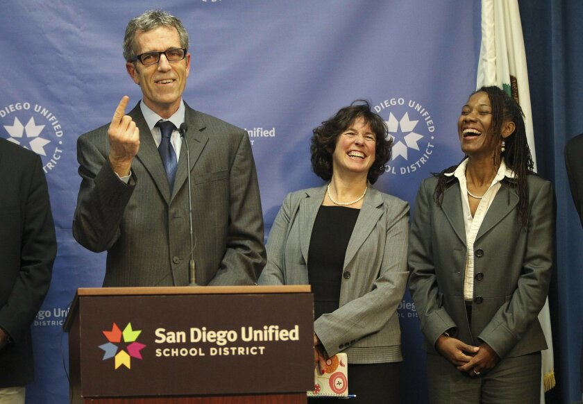 The San Diego School board announced Tuesday night that Cindy Marten will become the new San Diego Unified School District Superintendent to replace Bill Kowba who recently announced his retirement.  Board Member John Lee Evans introduces Cindy Marten (center) as board member Marne Foster shares a