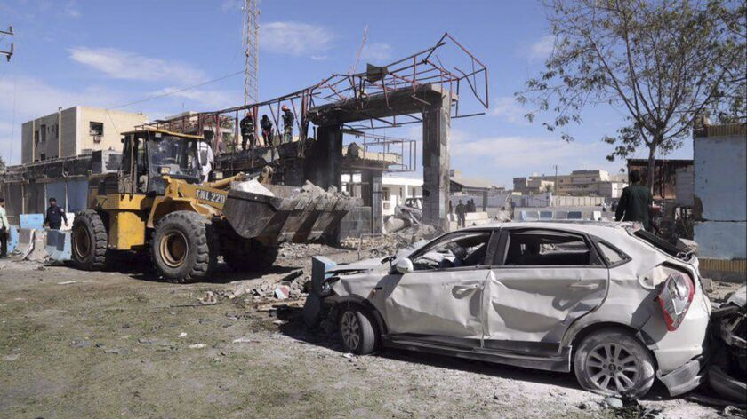 In this photo released by Tasnim News Agency, the wreckage of a car is seen after a suicide car bomb