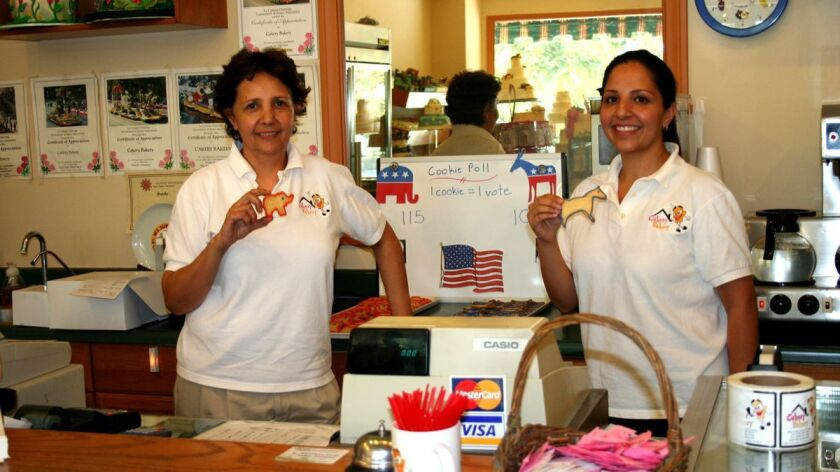Left to right, Zora and Sanam Yasseri of Cakery Bakery on Foothill Boulevard, display the elephant (