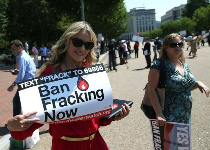 Actress Daryl Hannah, left, participates in a rally against fracking on federal land, in front of the White House. Hannah joined the group Americans Against Fracking to call on President Obama and the Bureau of Land Management to ban fracking on federal land.
