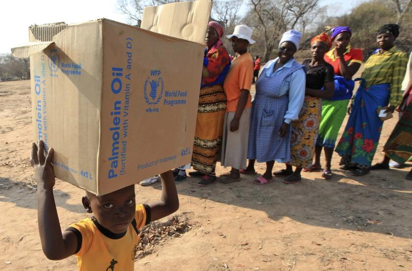 Men deliver U.N. World Food Program aid in Aslam, Hajjah, Yemen.
