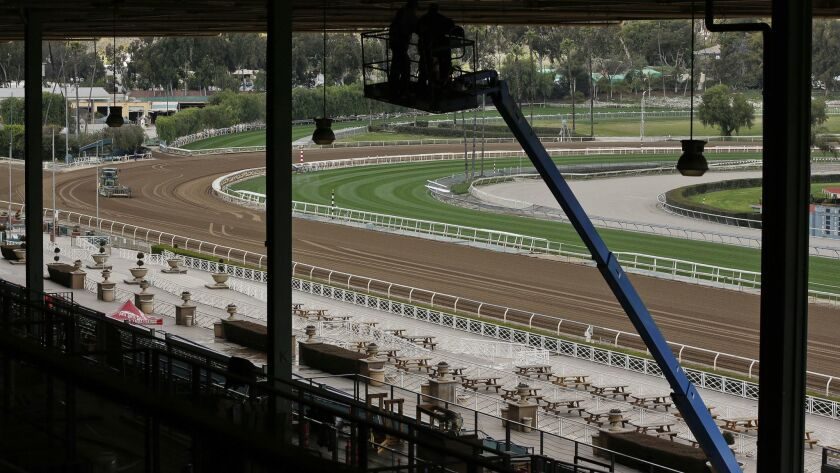 The Clockers' Corner area, the popular morning hangout for owners, trainers, jockeys and fans to watch workouts and grab breakfast, is empty at Santa Anita Park in Arcadia, Calif. on March 7.