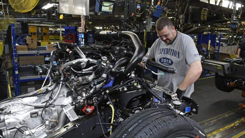 A worker assembles trucks at Ford's Kentucky Truck Plant in Louisville, Ky., in October.