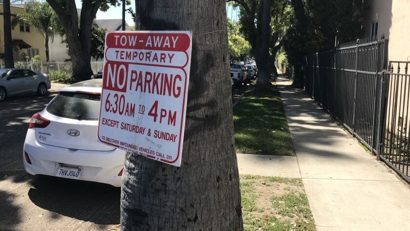 The Los Angeles Bureau of Street Services posts temporary no-parking signs on streets when repairs
