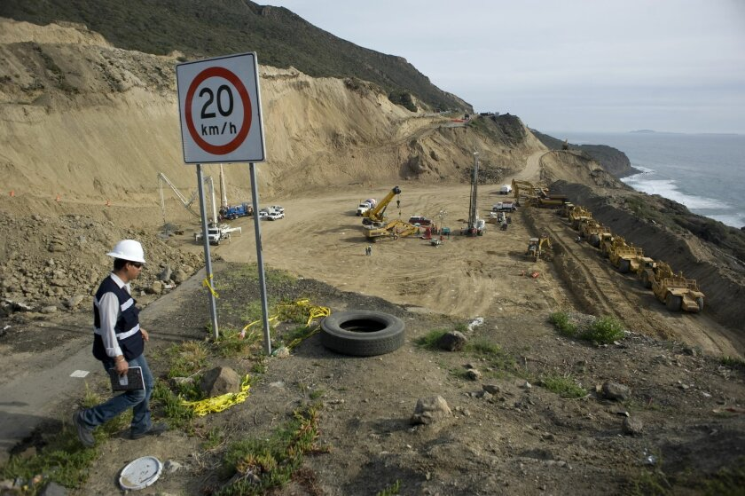 A construction site supervisor walks near the edge of a collapsed section of the Rosarito-Ensenada toll road on April 9, 2014 north of Ensenada, Mexico. This section of this highway was destroyed by a landslide in December 2013. .Photo - David Maung.April 9, 2014.Ensenada, Mexico