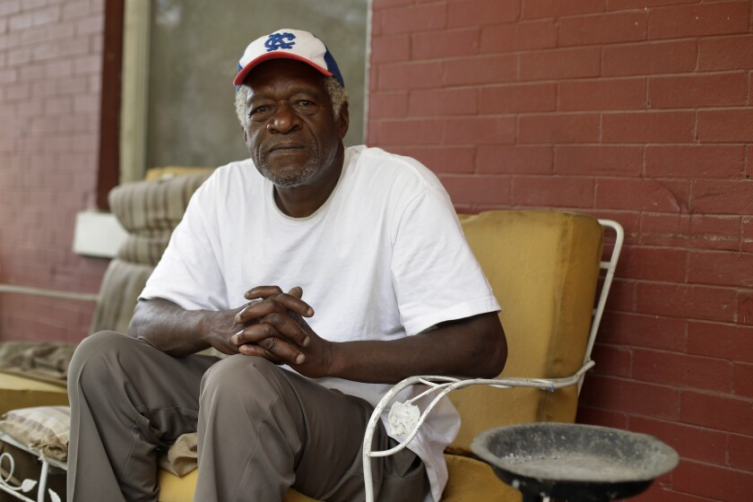"Gerald Armstrong recalls his time working for the old Kansas City Athletics as an attendant and ball boy in the visitor's clubhouse as he speaks from the front porch of the home where he grew up and now lives in Kansas City, Mo., on Friday, June 26, 2020. Armstrong is one of more than a dozen Black men who said they were sexually molested by former Red Sox clubhouse manager Donald ""Fitzy"" Fitzpatrick when they were youths. (AP Photo/Charlie Riedel)"