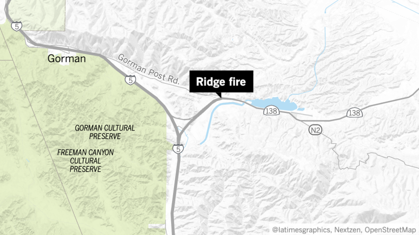 Firefighters were working to contain the 200-acre Ridge fire Monday afternoon.