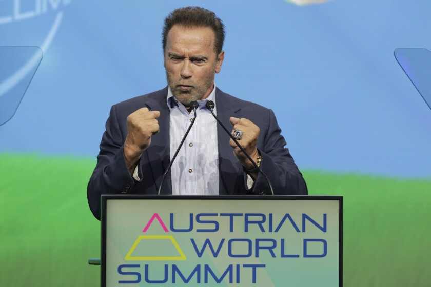 """Arnold Schwarzenegger, Founder of the """"Austrian World Summit"""" talks on stage about his dreams and actions to fight the climate crisis in Vienna, Austria, Thursday, July 1, 2021. (AP Photo/Lisa Leutner)"""