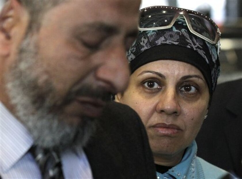Mona Daoud, right, looks at her husband Ahmed as he fights back tears after responding to a question about their son, Adel Daoud, in the federal courthouse lobby Thursday, Oct. 11, 2012, in Chicago. Adel Daoud pleaded not guilty on federal terrorism charges for allegedly trying to set off what he thought was a car bomb in downtown Chicago. (AP Photo/Charles Rex Arbogast)