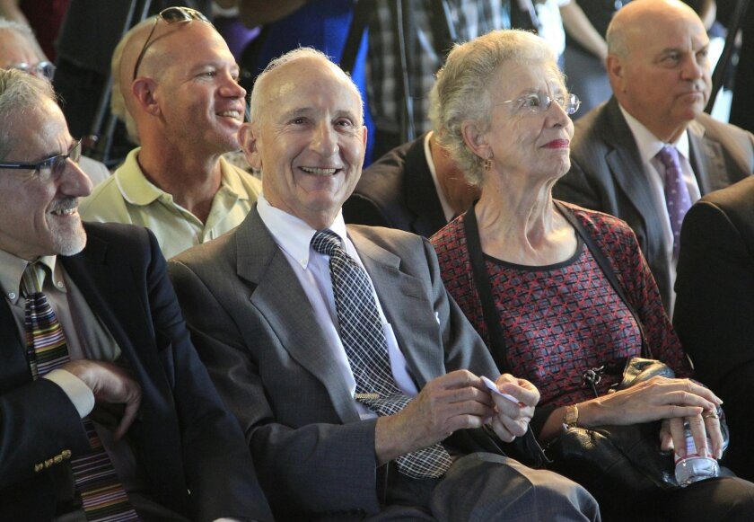 Ernest and Evelyn Rady, center, donated $120 million Monday to Rady Children's Hospital to create an institute capable of sequencing and analyzing the genome of every incoming patient.