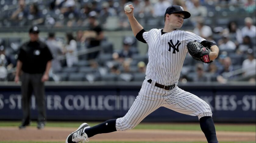 New York Yankees pitcher Sonny Gray delivers against the Cleveland Indians during the first inning o