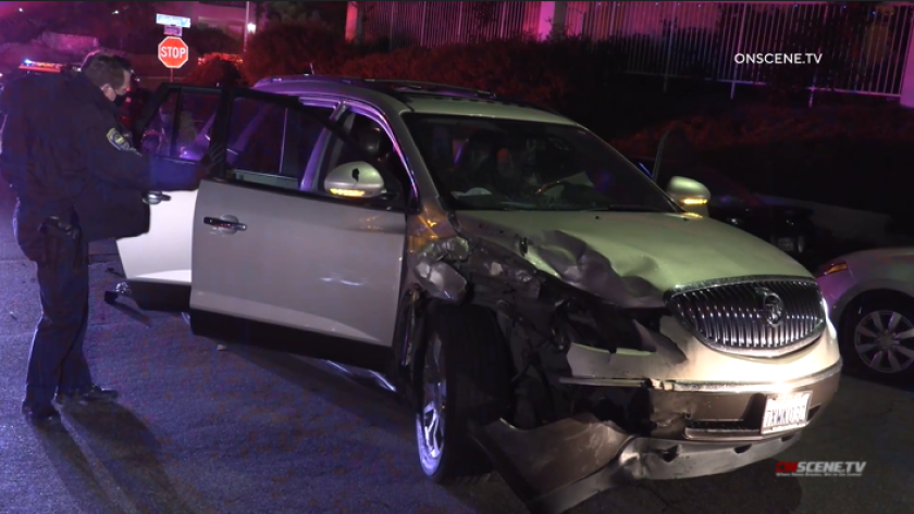 Three people were arrested early Sunday after crashing this stolen SUV into a parked car in Chula Vista.