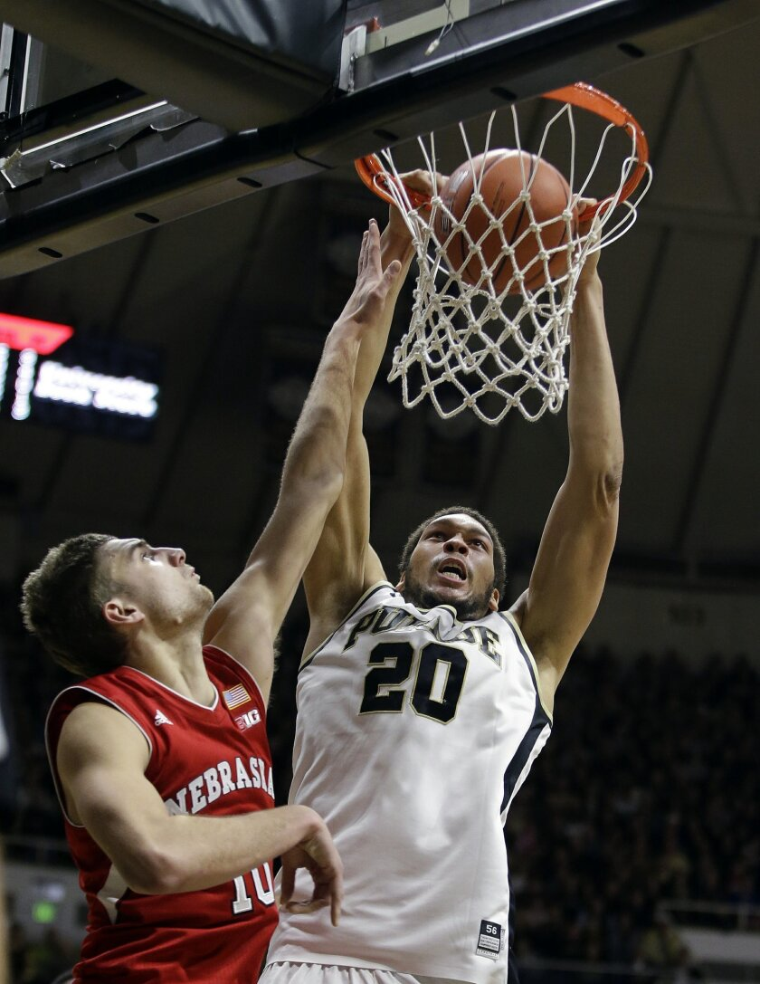 Purdue's A.J. Hammons (20) dunks against Nebraska's Jack McVeigh (10) during the second half of an NCAA college basketball game Saturday, Jan. 30, 2016, in West Lafayette, Ind. Purdue won 89-74. (AP Photo/Darron Cummings)