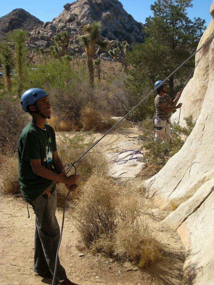 Idris Ahmed prepares for a rock-climbing adventure at Joshua Tree National Park as part of a trip with Outdoor Outreach.