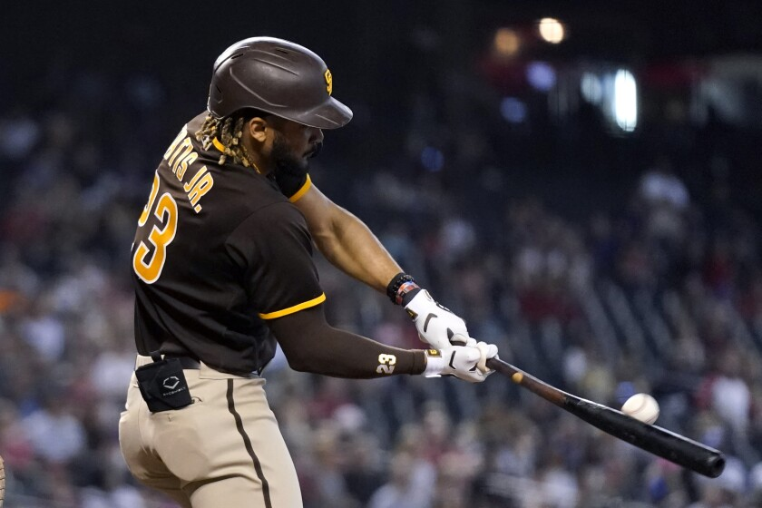 San Diego Padres' Fernando Tatis Jr. connects for a home run, his second of the baseball game, against the Arizona Diamondbacks during the fifth inning, Sunday, Aug. 15, 2021, in Phoenix. (AP Photo/Ross D. Franklin)