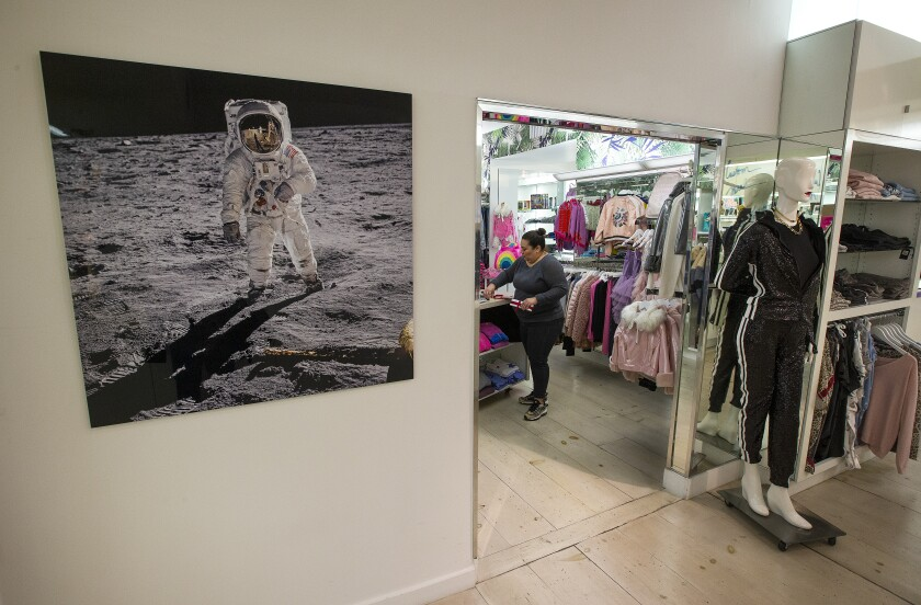 A photograph of astronaut Buzz Aldrin walking on the moon in Ron Robinson's store on Melrose Avenue.