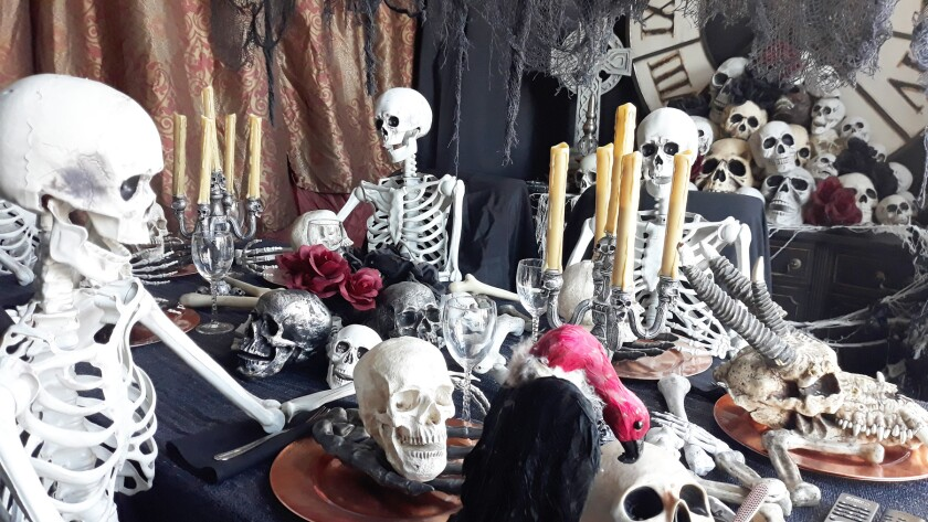 A skeleton dining room on display at Loveless Manor.