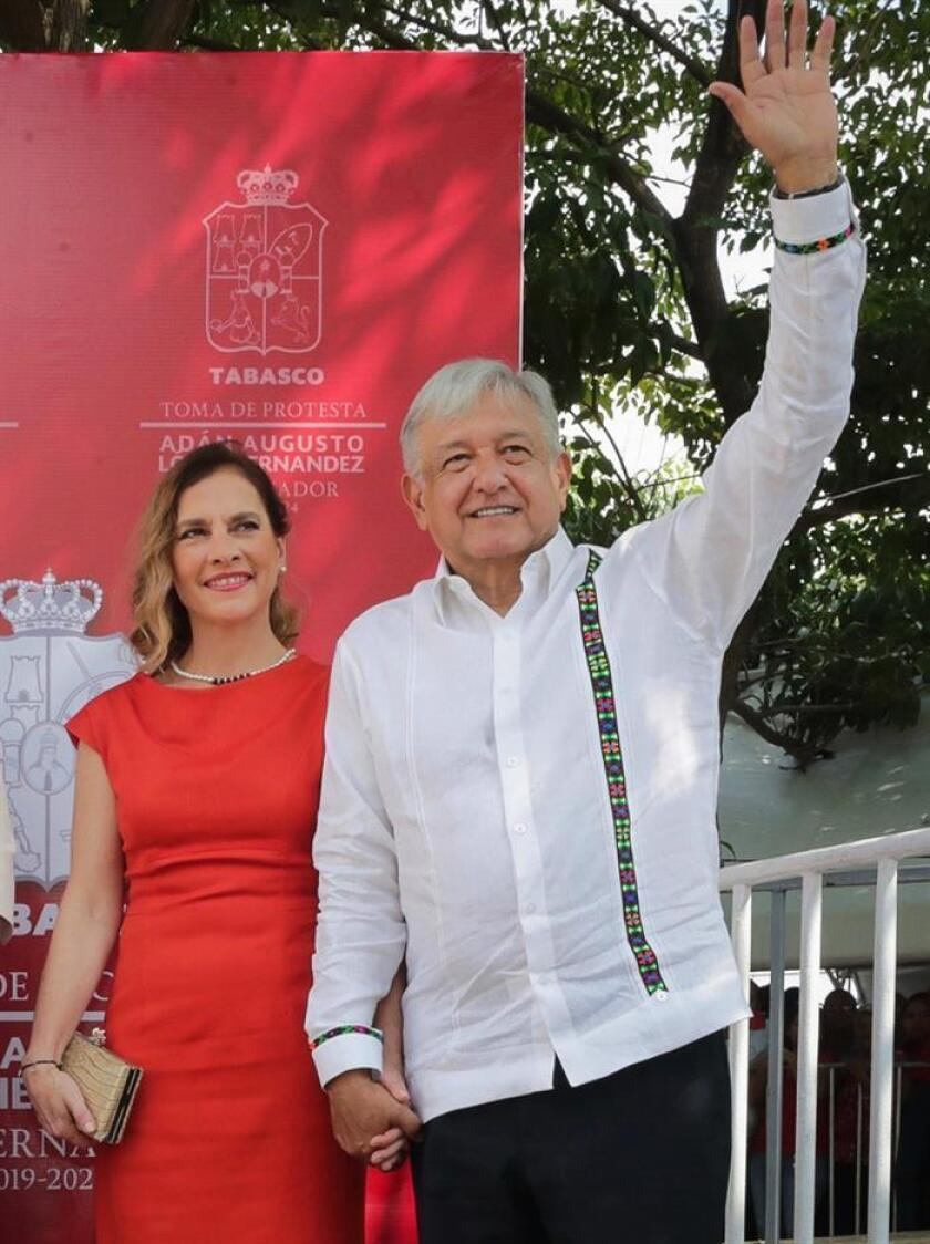 The Mexican government provided this photo of President Andres Manuel Lopez Obrador and first lady Beatriz Gutierrez Mueller attending the inauguration of the Tabasco state governor in Villahermosa on Monday, Dec. 31. EFE-EPA/PRESIDENCIA/EDITORIAL USE ONLY