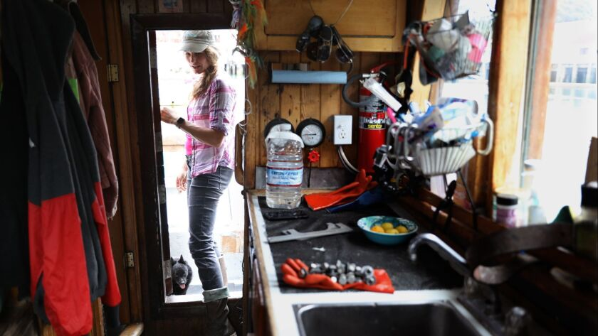 Heather Sears aboard her fishing boat Princess in Ft. Bragg. Sears has seen her catch dwindle as water is diverted to agriculture from rivers where salmon spawn.