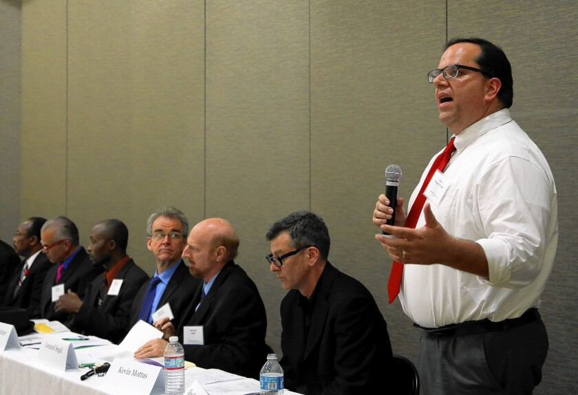 Alex Caputo-Pearl, right, answers a question during a UTLA president candidates forum at the Boyle Heights City Hall during the campaign for the post.