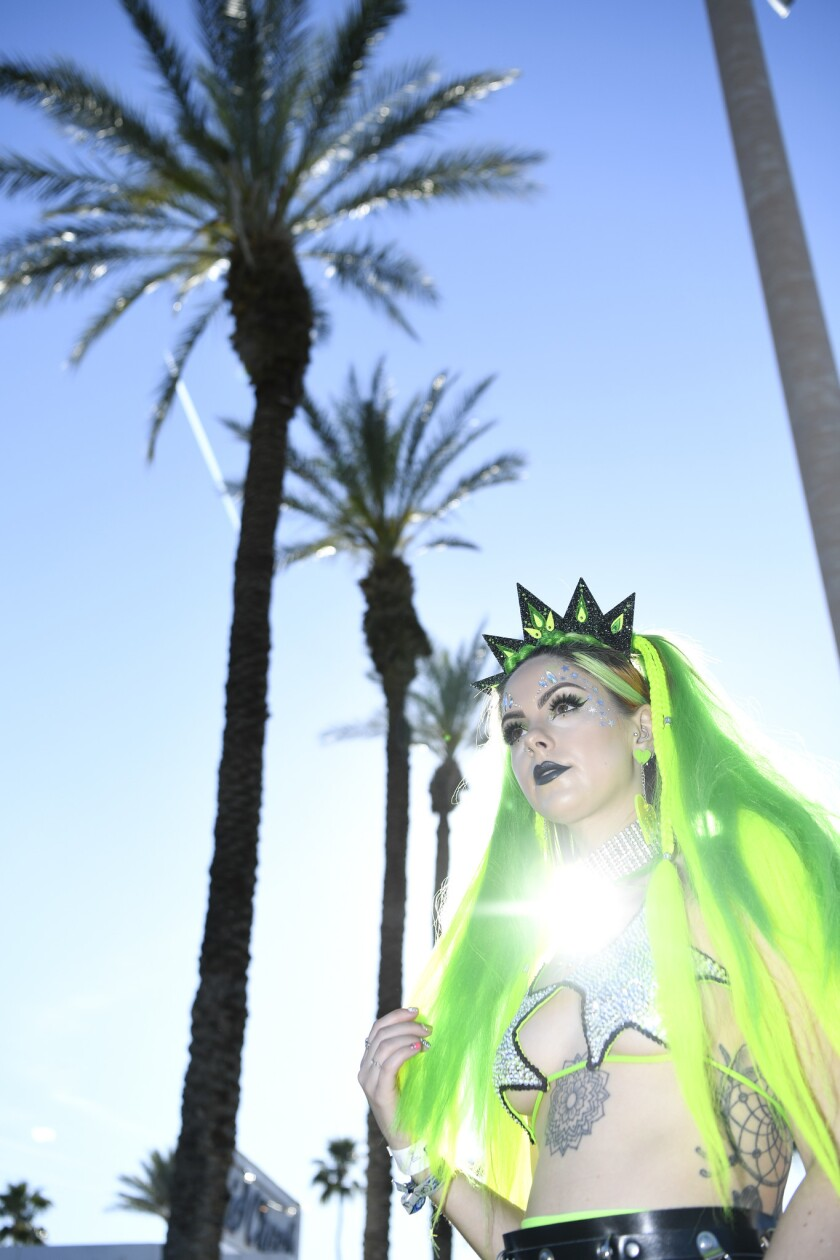 INDIO, CA-April 13, 2019: UK resident Sophie Hannah rocks what she calls her 'neon queen' outfit du