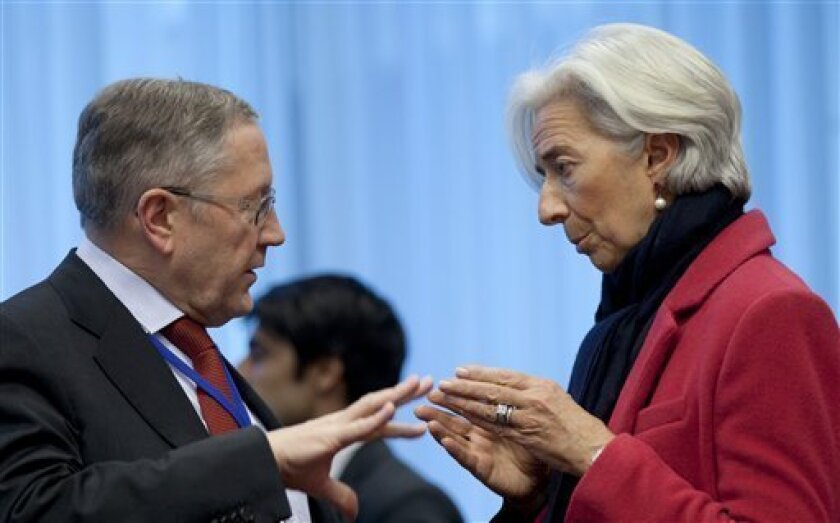 Managing Director of the International Monetary Fund Christine Lagarde, right, speaks with Chief Executive Officer of the European Financial Stability Facility Klaus Regling during a meeting of  eurogroup finance ministers in Brussels on Monday, March 4, 2013. The eurogroup finance ministers are se