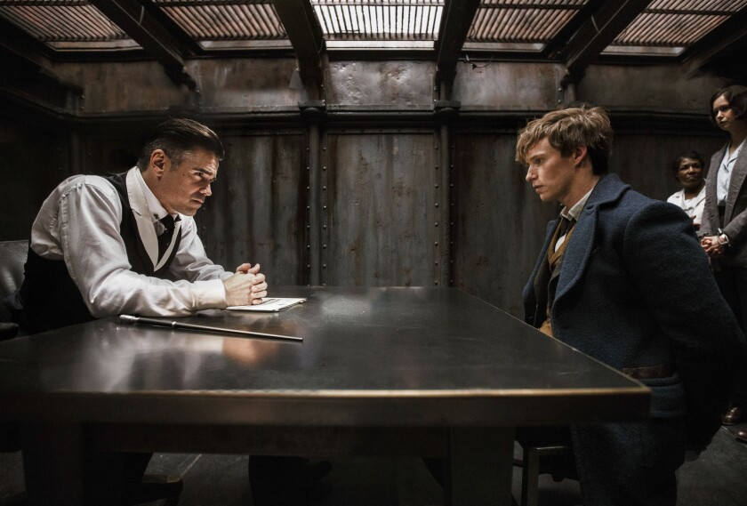 """Colin Farrell, left, and Eddie Redmayne appear in a scene from """"Fantastic Beasts and Where to Find Them."""""""