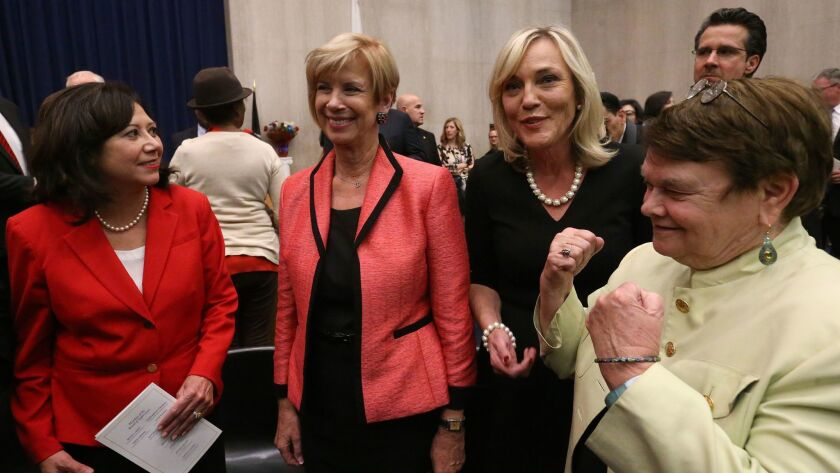 Los Angeles supervisors Hilda Solis, Janice Hahn, Kathryn Barger and Sheila Kuehl after Barger was sworn into the Los Angeles County Board of Supervisors in Los Angeles on Dec. 5, 2016.