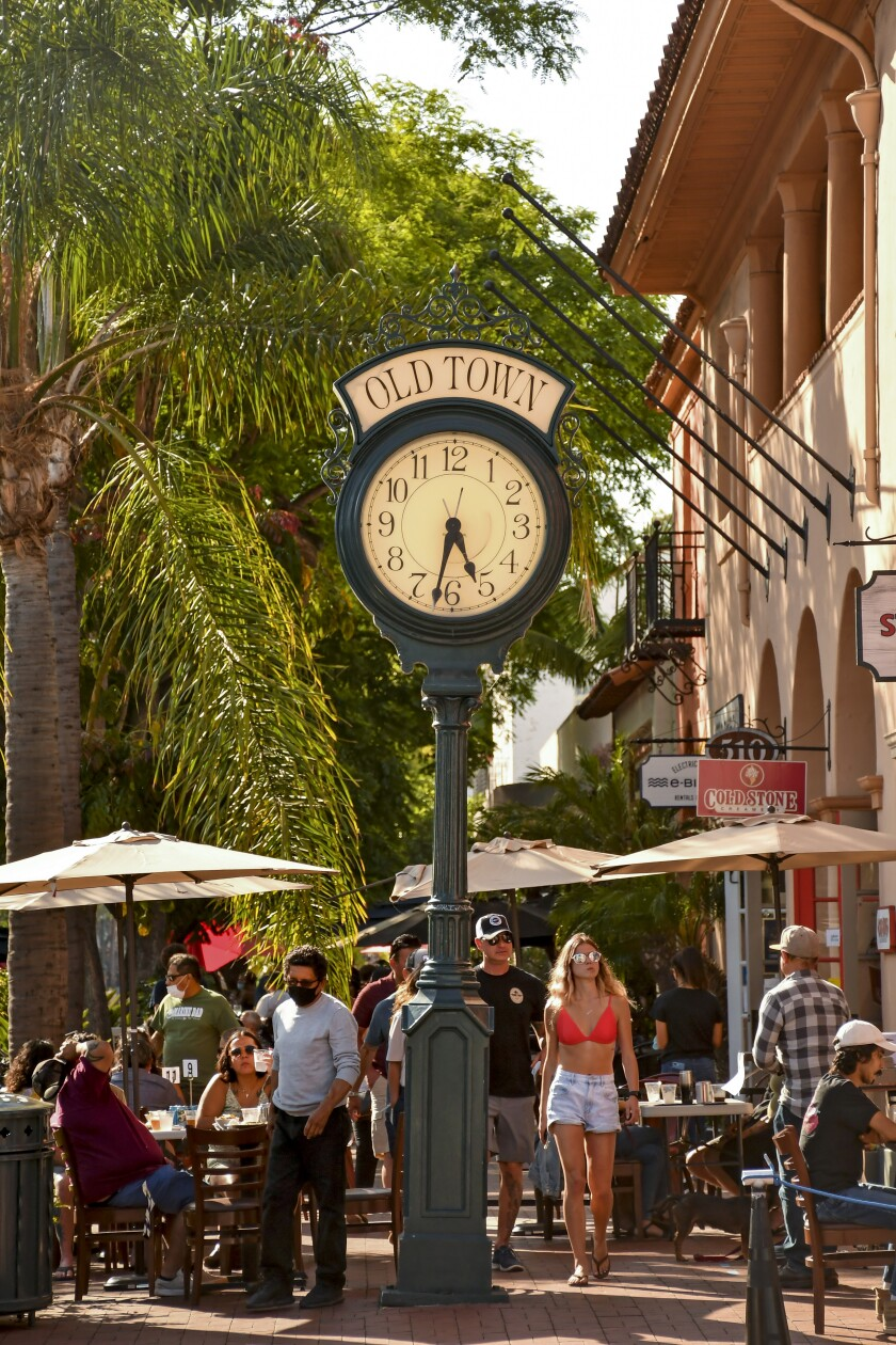 Santa Barbara banned cars from eight blocks of State Street in late May. Pedestrian crowds came, some with masks, some not.
